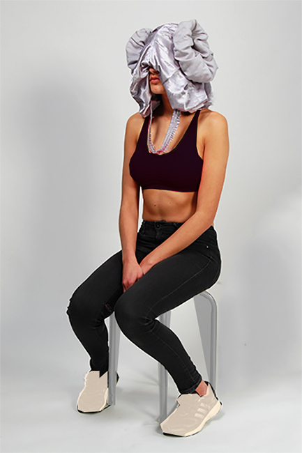 Picture of model on stool showcasing a piece of the 'silhouettes'-collection